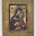 """Portable Mosaic Icon with the Virgin Eleousa, early 14th century Byzantine, probably Constantinople Miniature mosaic set in wax on wood panel with gold, multicolored stones, and gilded copper tesserae; some portions restored 4 3/8 x 3 3/8 in. (11.2 x 8.6 cm) Gift of John C. Weber, in honor of Philippe de Montebello, 2008 (2008.352) In the fourteenth century, Byzantine artists developed a new art form: micromosaics worked in exceptionally tiny tesserae in a painterly style. These intimate images were made primarily for use in private devotions, and few of them survive. The Museum's micromosaic, which depicts the Virgin Eleousa, the Virgin of Compassion, emphasizes the humanness of the Christ Child, as he reaches forward to touch his head to his mother's cheek. The Virgin lovingly embraces her son, while her mournful gaze invites the viewer to contemplate his future sacrifice and death. On the reverse of this mosaic is an inscription in a late fifteenth-century Humanist hand that identifies it as the icon that moved Saint Catherine of Alexandria to convert to Christianity in the fourth century. Such labels attest to the popularity of micromosaics in the Latin West, where, during the Renaissance, they were often inaccurately dated to the first Christian centuries. This icon first came to scholarly attention when it was lent to the Museum's 2004 exhibition """"Byzantium: Faith and Power (1261–1557)."""" Related"""