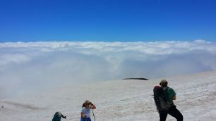 Breaking out above the clouds on the Muir Snowfield over 9000'