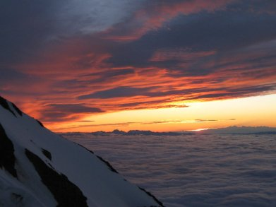 Sunrise above the clouds on Mt Rainier!